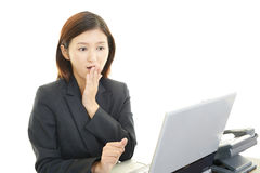 Surprised female office worker Royalty Free Stock Photo