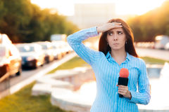 Surprised Female Reporter on Field in Traffic Stock Image