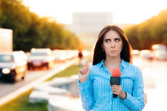 Surprised Female Reporter on Field in Traffic Royalty Free Stock Photography