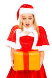 Surprised female Santa with Christmas gift Royalty Free Stock Images