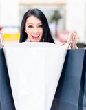 Surprised female shopper Royalty Free Stock Photography