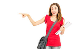 Surprised female student pointing to copy space Royalty Free Stock Photo