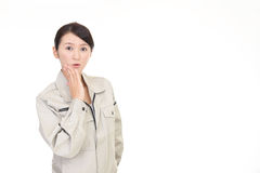 Surprised female worker. Portrait of a female worker Stock Images