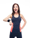 Surprised fitness woman pointing finger down Stock Photography