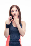Surprised fitness woman talking on the phone Royalty Free Stock Image