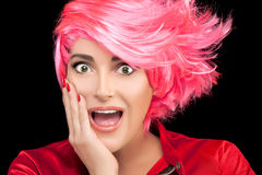 Surprised or flattered woman with pink hair Stock Photography