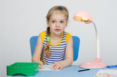 Surprised four-year girl draws pencils Royalty Free Stock Photography