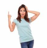 Surprised friendly hispanic woman pointing up Stock Photos