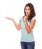 Surprised friendly woman holding her right hand up Royalty Free Stock Photo