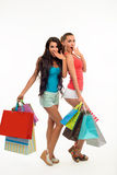 Surprised friends with many shopping bags. Stock Image