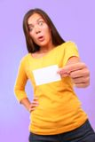Surprised funny asian business card woman. Surprised funny asian woman with business card. Beautiful cute mixed race caucasian / chinese young woman model Royalty Free Stock Photography