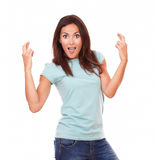 Surprised funny brunette with luck sign Stock Images