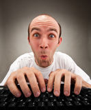 Surprised funny nerd working on computer Royalty Free Stock Photo