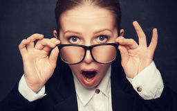 Surprised funny teacher in glasses shouts. At the school board royalty free stock photos