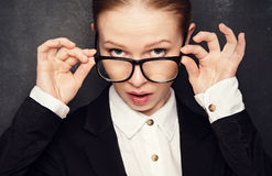 Surprised funny teacher in glasses shouts Royalty Free Stock Images
