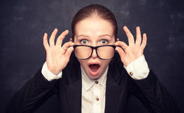 Surprised funny teacher in glasses shouts stock photography