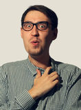 Surprised funny young man wearing glasses Stock Image