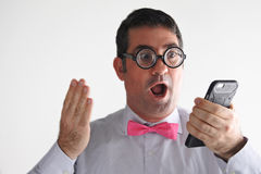 Surprised Geeky man receives a surprising message or phone call Royalty Free Stock Photography