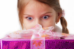 She is surprised by a gift package Royalty Free Stock Photo
