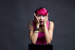 Surprised girl. With pink hair and colorful body art tattoos stock photography