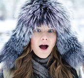 Surprised girl. In fure hat at the winter forest Royalty Free Stock Image