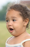 Surprised Girl. A close-up of a surprised toddler girl standing outside Royalty Free Stock Images