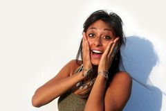 Surprised Girl. White surprised woman / White teeth and black hair / Brown Skin Royalty Free Stock Image
