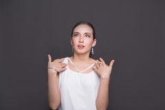 Surprised girl with arms on her body in disbelief Stock Images