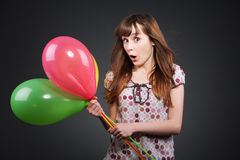 Surprised girl with balloons Royalty Free Stock Image