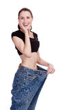 Surprised girl in big jeans. Royalty Free Stock Photos