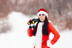Surprised Girl with Binoculars Looking for Christmas Stock Images