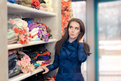 Surprised  Girl in Blue Trench Coat Shopping Stock Images