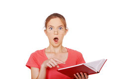 Surprised girl with book Royalty Free Stock Image