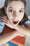 Surprised girl with books Stock Photo