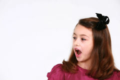 Surprised girl with bow Royalty Free Stock Image