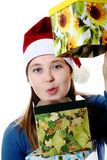 A surprised girl in a cap with  boxes Royalty Free Stock Photo