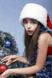Surprised girl in a cap with the Christmas Stock Image
