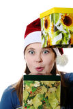 A surprised girl in a cap with two gift boxes Stock Photo