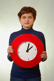 Surprised girl with clock Royalty Free Stock Photos