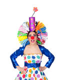 Surprised girl clown with a big colorful wig Royalty Free Stock Image