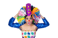 Surprised girl clown with a big colorful wig Royalty Free Stock Photography