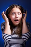 Surprised girl with a colander on her head Stock Photo