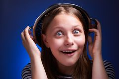 Surprised girl with a colander on her head Stock Photos