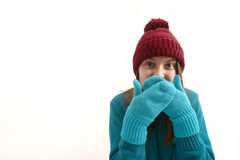 Surprised girl in colorful winter clothes on white Stock Images