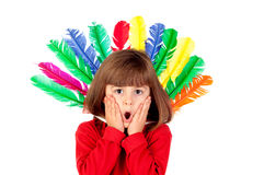 Surprised girl with colorfully feathers. Isolated on a white background Stock Images