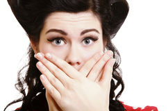Surprised girl covering her mouth by the hands Royalty Free Stock Photography