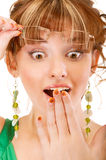 Surprised girl covers mouth with palm Royalty Free Stock Image