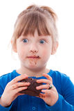 Surprised girl dirty with chocolate cake Stock Photo