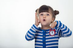 Surprised girl in dress with red clock on white background. royalty free stock photos
