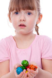 Surprised girl with Easter eggs at hands Stock Photos